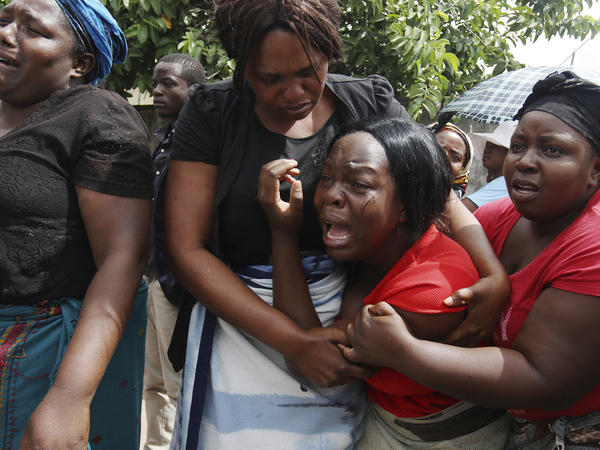 A family member of Kelvin Tinashe Choto reacts, during his funeral in Chitungwiza, about 30 kilometres south east of the capital, Harare, Zimbabwe on Saturday. The 22-year-old was shot in the head, one of at least a dozen people killed in a violent crackdown by security after protests over high fuel prices.