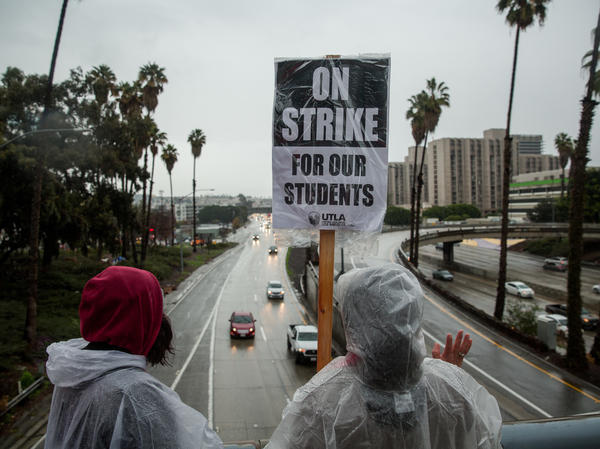 Demonstrators hold a sign during a teachers strike in Los Angeles, California, U.S.