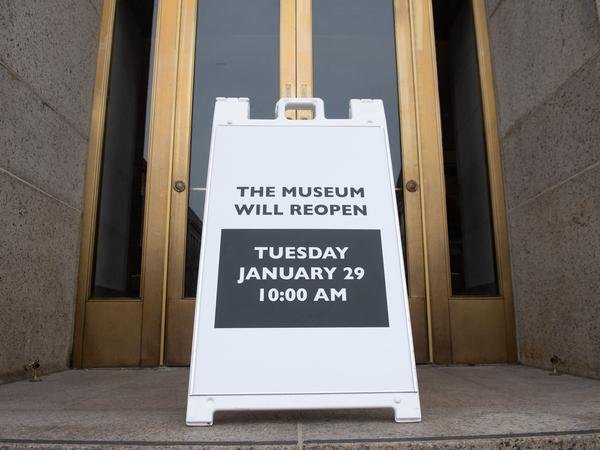 A sign at the entrance of the Smithsonian National Museum of Natural History in Washington, D.C., says the museum will reopen Tuesday. The shutdown reduced federal spending by $18 billion, although most of that will be recouped now that the government has reopened, according to a new report.