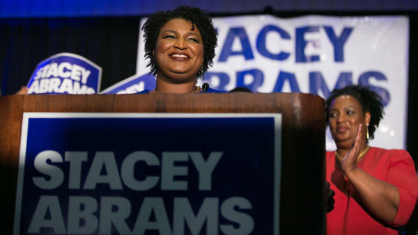 Then-Georgia Democratic gubernatorial candidate Stacey Abrams takes the stage to declare victory in the primary during an election night event in May 2018.