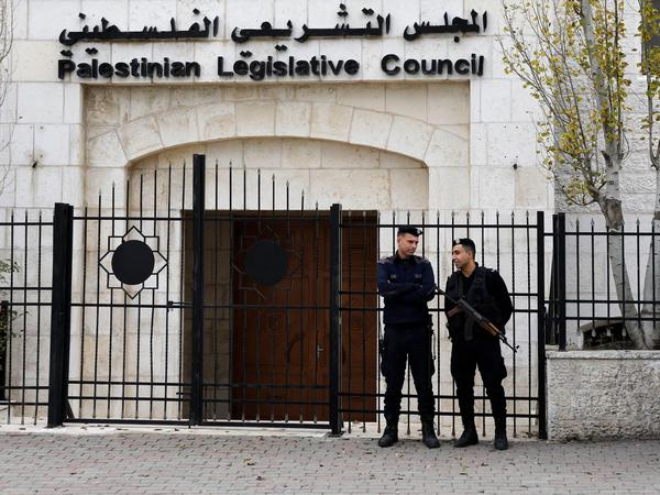 Palestinian security forces gather in front of the Palestinian Legislative Council building in Ramallah in the Israeli-occupied West Bank in December.