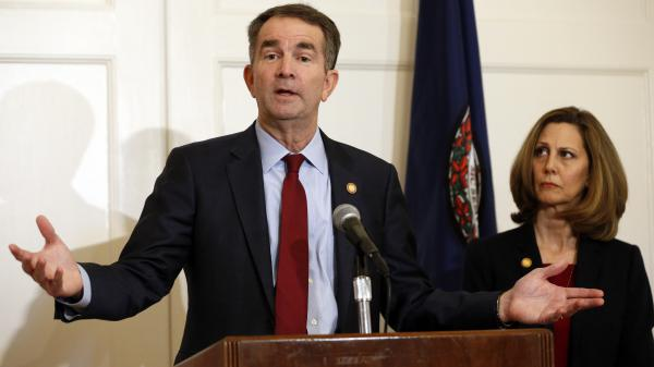 Virginia Gov. Ralph Northam, accompanied by his wife, Pam, speaks during a news conference on Saturday. Northam has resisted widespread calls for his resignation.