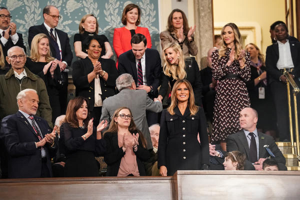 First lady Melania Trump stands with her guests ahead of Tuesday's State of the Union address.