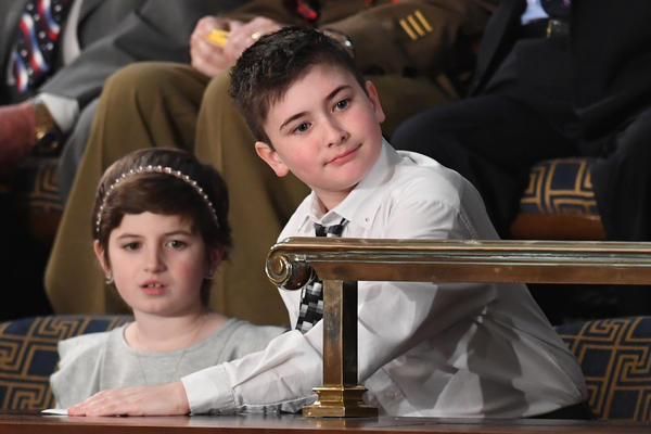 Special guest Grace Eline, left, and sixth grade student Joshua Trump, right, attends the State of the Union address.