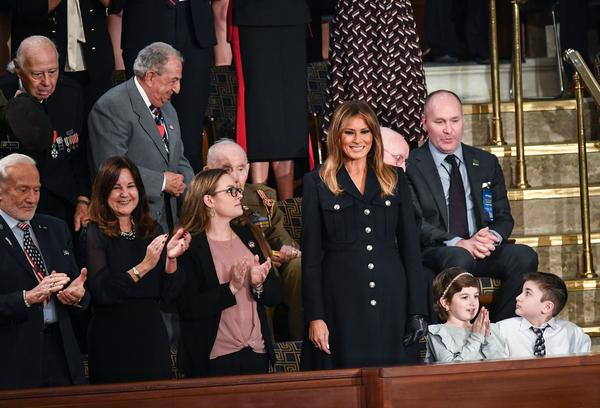 First Lady Melania Trump, center, is greeted, surrounded by special guests of the President.