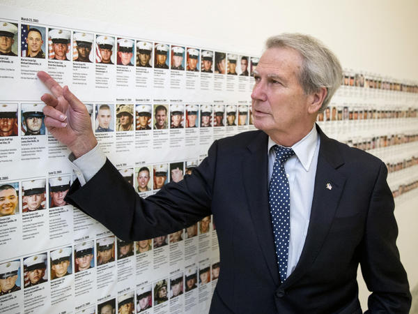In this file photo, U.S. Rep. Walter Jones, R-N.C., stands in front of photos of fallen soldiers along a hallway leading to his office on Capitol Hill in Washington, D.C. Jones, a once-fervent supporter of the 2003 invasion of Iraq who later became an equally outspoken Republican critic of the war, died Sunday.