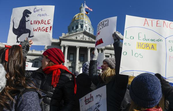 Teachers from Castro Elementary School cheer at a rally at the Colorado State Capitol on Monday.