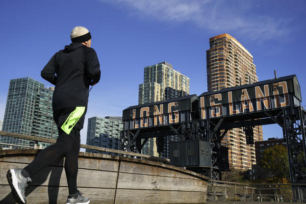 A man runs along the waterfront in the Long Island City neighborhood of the Queens borough of New York City, which had been the planned location for a secondary Amazon headquarters.