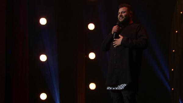 """Comedian Mo Amer, seen here in his Netflix special <em>The Vagabond</em>, says that stand-up has been a significant part of his """"coping process"""" with an itinerant childhood."""