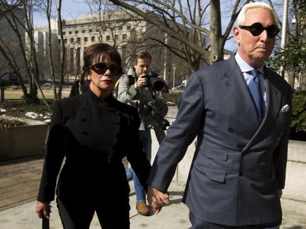 Roger Stone, accompanied by his wife, Nydia, arrives at federal court in Washington, D.C., on Thursday. The former campaign adviser for President Trump has been forbidden to speak publicly about his case.