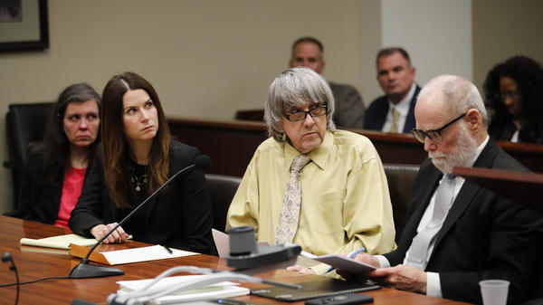 David Turpin (second from right) and his wife, Louise (far left), joined by their attorneys, pleaded guilty in a Riverside, Calif., courtroom, Friday to 14 counts, including torture, after some of their 13 children were found shackled to beds.