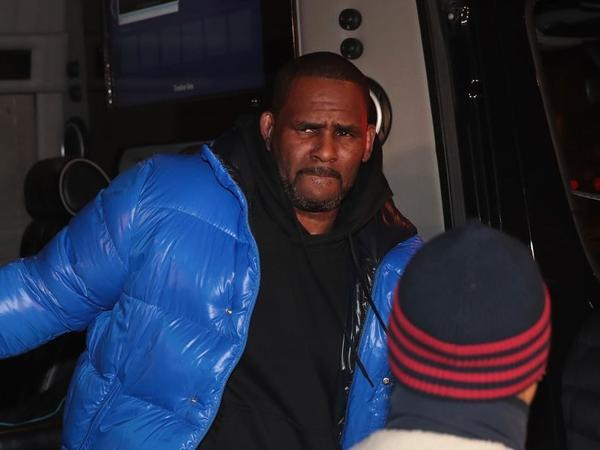R. Kelly turns himself in at Chicago's 1st District-Central police station on Friday evening. Earlier that day, Kelly was indicted on 10 counts of aggravated criminal sexual abuse.
