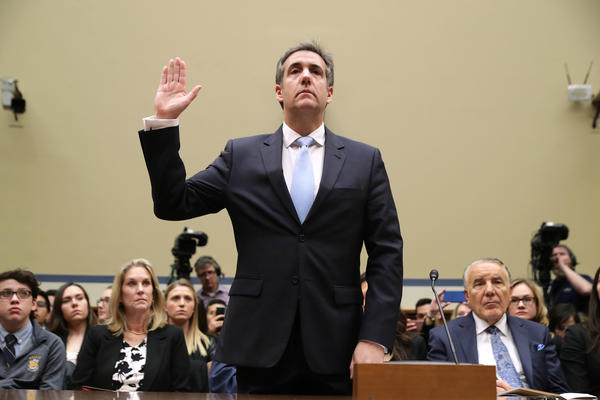 Michael Cohen, former attorney and fixer for President Trump, testifies before the House Oversight and Government Reform Committee on Wednesday.