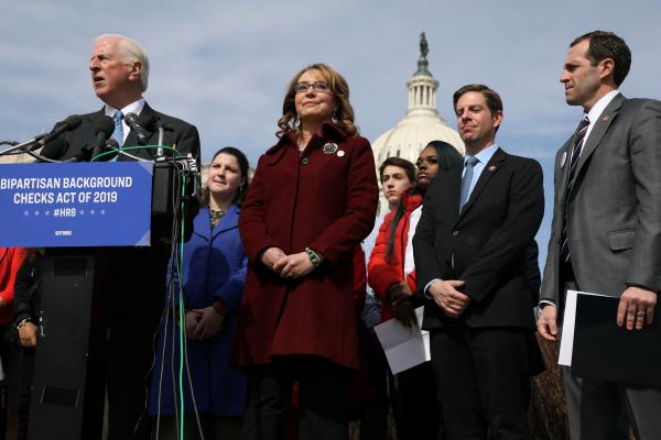 U.S. Rep. Mike Thompson (left), D-Calif., joined by shooting survivor and former Rep. Gabby Giffords of Arizona, holds a news conference about his proposed gun background check legislation, on Capitol Hill on Tuesday.