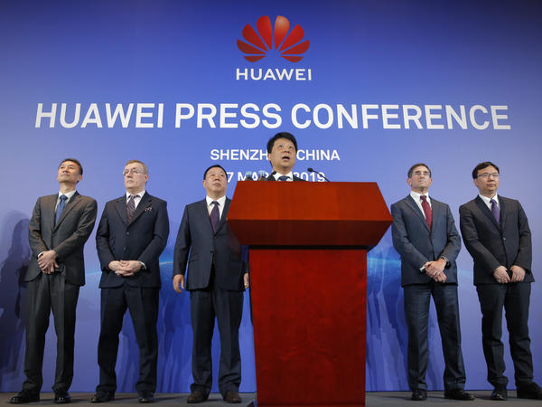 Huawei Rotating Chairman Guo Ping (center) speaks in front of other executives during a press conference in Shenzhen, in China's Guangdong province, on Thursday.