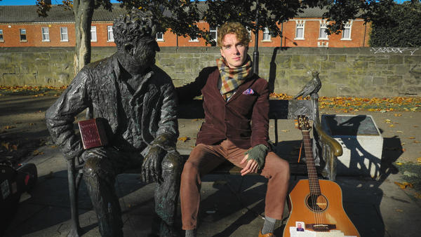 David Keenan sits with a statue of the beloved Irish writer and poet Brendan Behan along the Royal Canal in Dublin.