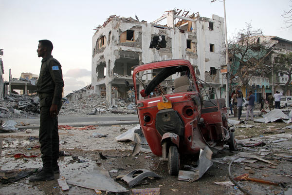 A Somali soldier stands near a destroyed building in Mogadishu, Somalia, on  March 1 after police blamed a nearly day-long siege of the  Somali capital on al-Shabab extremists.