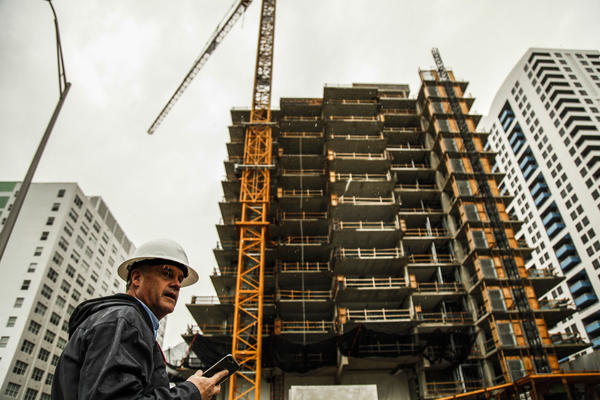 A construction worker at the Monad Terrace luxury development, a high-rise in Miami Beach that has been designed to withstand several decades of climate change and sea level rise.