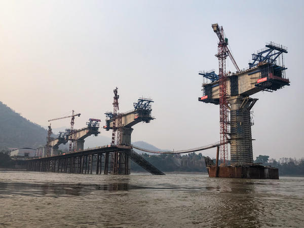 Giant concrete pylons rise from the Mekong River north of Luang Prabang, where a bridge is under construction.