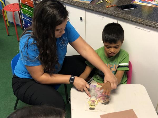 Ana Lopez Del Castillo, a registered behavior technician, works with a child at Amazing Gains Behavior Therapy Services in Orlando.