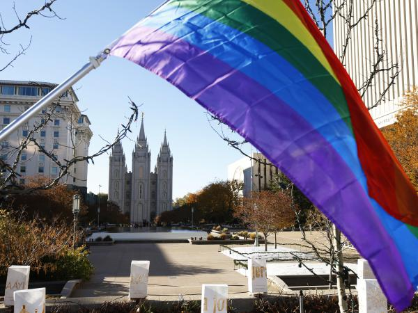 The Church of Jesus Christ of Latter-day Saints announced Thursday that it will no longer consider people in same-sex marriages to be apostates. Here, a pride flag flies in front of the Historic Mormon Temple in Salt Lake City as part of a 2015 protest of the church's LGBT policies.