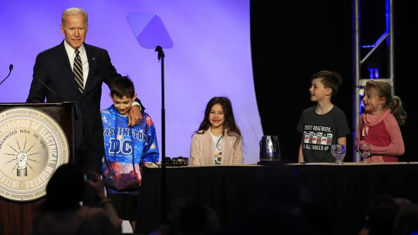 Former Vice President Joe Biden is joined by some children onstage, as he speaks at an International Brotherhood of Electrical Workers conference Friday in Washington.