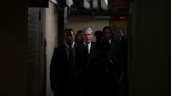 Special counsel Robert Mueller, center, leaves after a closed meeting with members of the Senate Judiciary Committee on June 21, 2017, at the Capitol in Washington, D.C.