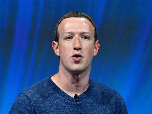 Facebook's CEO Mark Zuckerberg speaks at a trade fair in 2018. The company says it will use artificial intelligence to figure out which of its users have died.