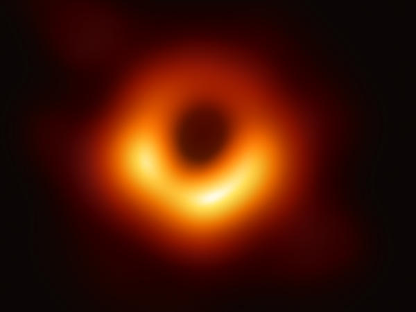 "The first-ever image of a black hole was released Wednesday by a consortium of researchers, showing the ""black hole at the center of galaxy M87, outlined by emission from hot gas swirling around it under the influence of strong gravity near its event horizon."""