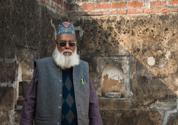 Syed Ikhlaq Latifi, 80, stands on the roof of his home, from where he watched in horror as a mob of Hindu activists destroyed the Babri Masjid in 1992.