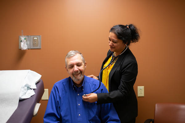 """Geriatric oncologist Supriya Gupta Mohile meets with patient Jim Mulcahy at Highland Hospital in Rochester, N.Y. """"If I didn't do a geriatric assessment and just looked at a patient I wouldn't have the same information,"""" she says."""