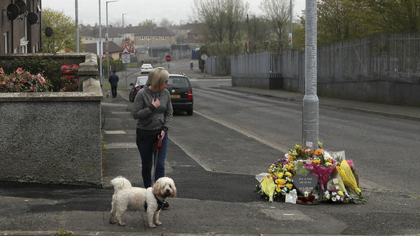 A woman stops to pay her respects Saturday at the scene where 29-year-old journalist Lyra McKee was fatally shot in Londonderry, Northern Ireland.