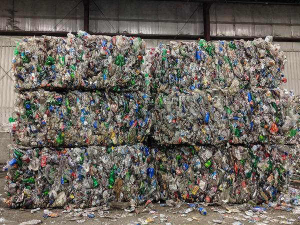 Bales of plastic bottles sit in a warehouse at Stutzman Refuse Disposal in Hutchinson, Kansas