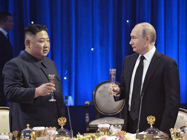 Russian President Vladimir Putin (right) toasts with North Korea's leader Kim Jong Un after their talks in Vladivostok, Russia, on Thursday.