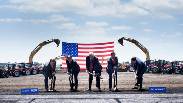 """President Trump participates in a groundbreaking for the Foxconn campus in Mount Pleasant, Wis., in June 2018. With him are Christopher """"Tank"""" Murdock (from left), the first Wisconsin Foxconn employee; former Gov. Scott Walker, Foxconn Chairman Terry Gou and former Speaker of the House Paul Ryan."""