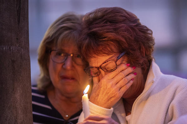People at Rancho Bernardo Community Presbyterian Church in San Diego attend a prayer and candlelight vigil for victims of the synagogue shooting in Poway, Calif., on Saturday.