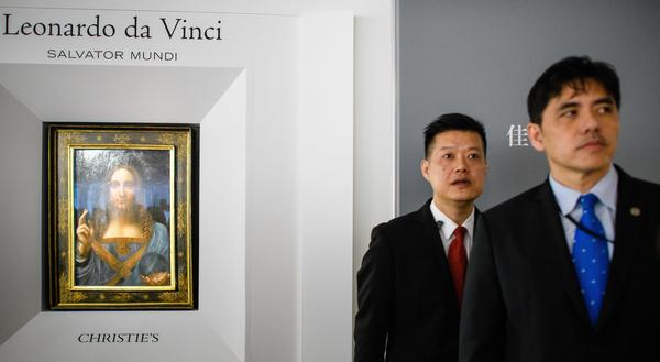 The Hong Kong media identified the man on the right as former CIA officer Jerry Chun Shing Lee. He was a security official at the unveiling of Leonardo da Vinci's <em>Salvator Mundi</em> painting at the Christie's showroom in Hong Kong on Oct. 13, 2017. Three months later, Lee was arrested at JFK airport in New York. He pleaded guilty in U.S. federal court Wednesday to spying for China.