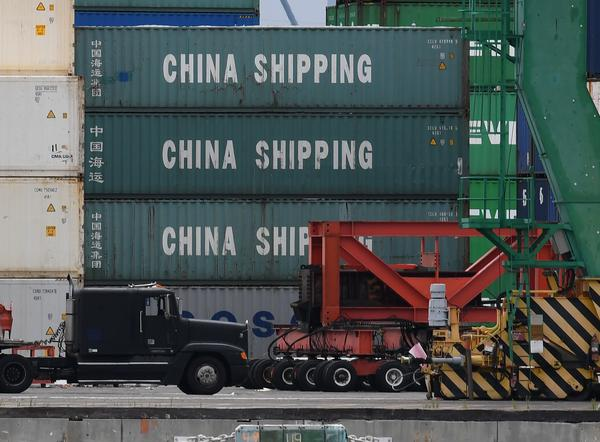 Cargo is unloaded from a container ship at the main port terminal in Long Beach, Calif., on Friday. Two days of trade talks between the U.S. and China ended without a deal to avert more tariffs.