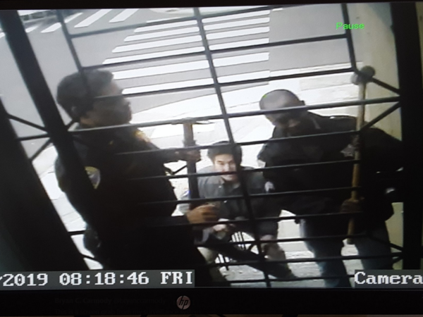 A still from a surveillance camera at the home of Bryan Carmody, which was raided by San Francisco police on Friday.