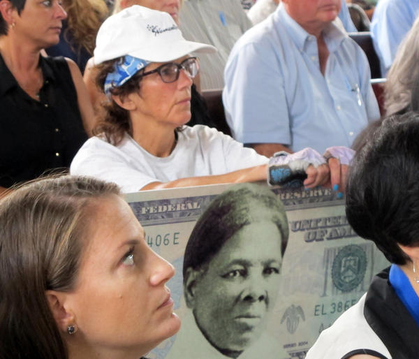 A woman holds a sign in 2015 supporting Harriet Tubman for the $20 bill during a town hall meeting at the Women's Rights National Historical Park in Seneca Falls, N.Y.