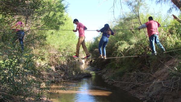 U.S. citizens use ropes to cross the Rio Grande from San Antonio del Bravo, Mexico, into Candelaria, Texas. U.S. citizens depend on the free health clinic in San Antonio del Bravo.