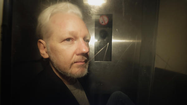 WikiLeaks founder Julian Assange is taken from court, where he appeared on charges of jumping British bail seven years ago, in London on May 1.