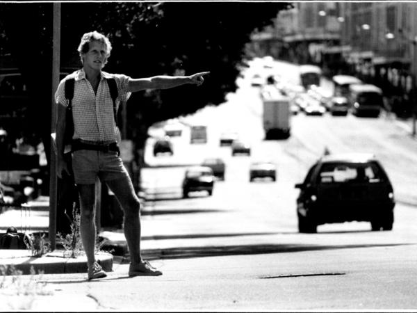 "Tony Horwitz, seen hitchhiking in Australia in 1986, wrote about the experience later in his book <em>One for the Road: Hitchhiking Through the Australian Outback</em>. Horwitz, who would go on to win the <a href=""https://www.pulitzer.org/winners/tony-horwitz"">1995 Pulitzer Prize for national reporting,</a> died Monday at the age of 60."