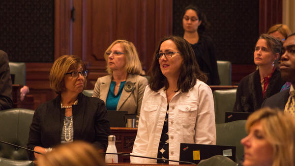 State Rep. Kelly Cassidy, in white, watches as the Reproductive Health Act passes in the Illinois House. The Chicago Democrat sponsored the legislation.