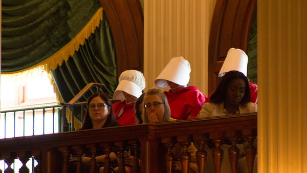 Women wearing costumes from 'The Handmaid's Tale' have been a frequent presence in the Capitol this spring. Margaret Atwood's novel (and recent TV series) posits a dystopian future in which fertile women are enslaved for breeding.