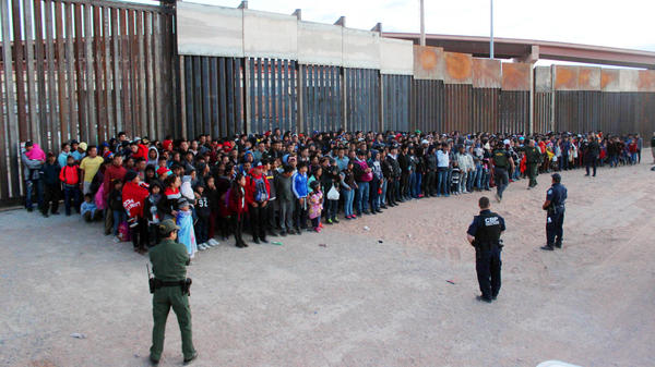 President Trump has announced plans to impose escalating tariffs on goods imported from Mexico in an attempt to stop migrants from entering the U.S. over the southern border. Shown here are migrants at the border in El Paso, Texas, on Wednesday.