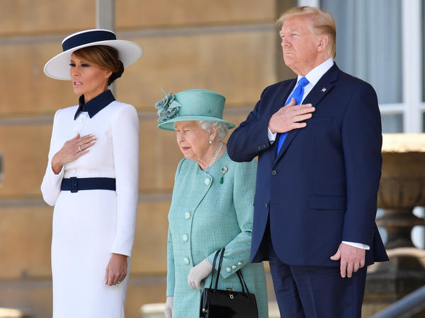 President Trump and first lady Melania Trump were welcomed to the U.K. by Queen Elizabeth II in a ceremony Monday at Buckingham Palace.