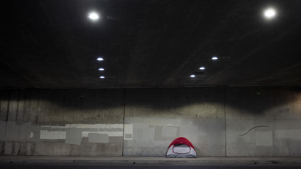 A tent is pitched on a sidewalk underneath the 110 Freeway in Los Angeles earlier this year. Los Angeles County has seen an increase in homelessness, and local officials blame rising rents and evictions.