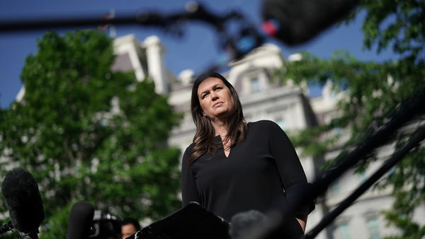Sarah Sanders talks to reporters outside the White House on April 29. Sanders will be leaving her post as press secretary at the end of the month.