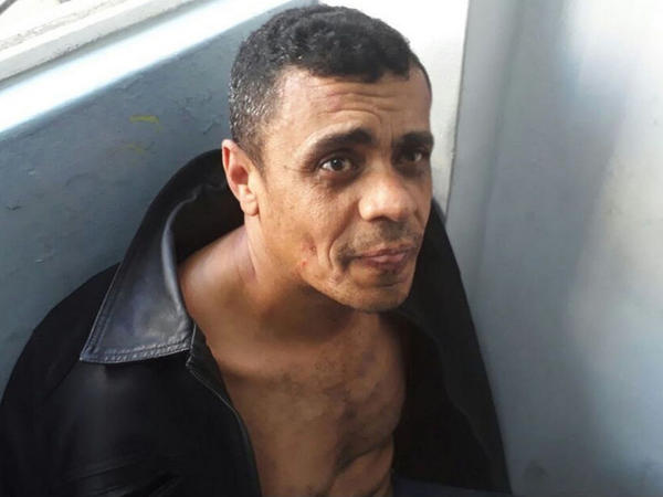 Adélio Bispo de Oliveira, who confessed to stabbing Jair Bolsonaro, sits after being detained following the attack in September 2018.